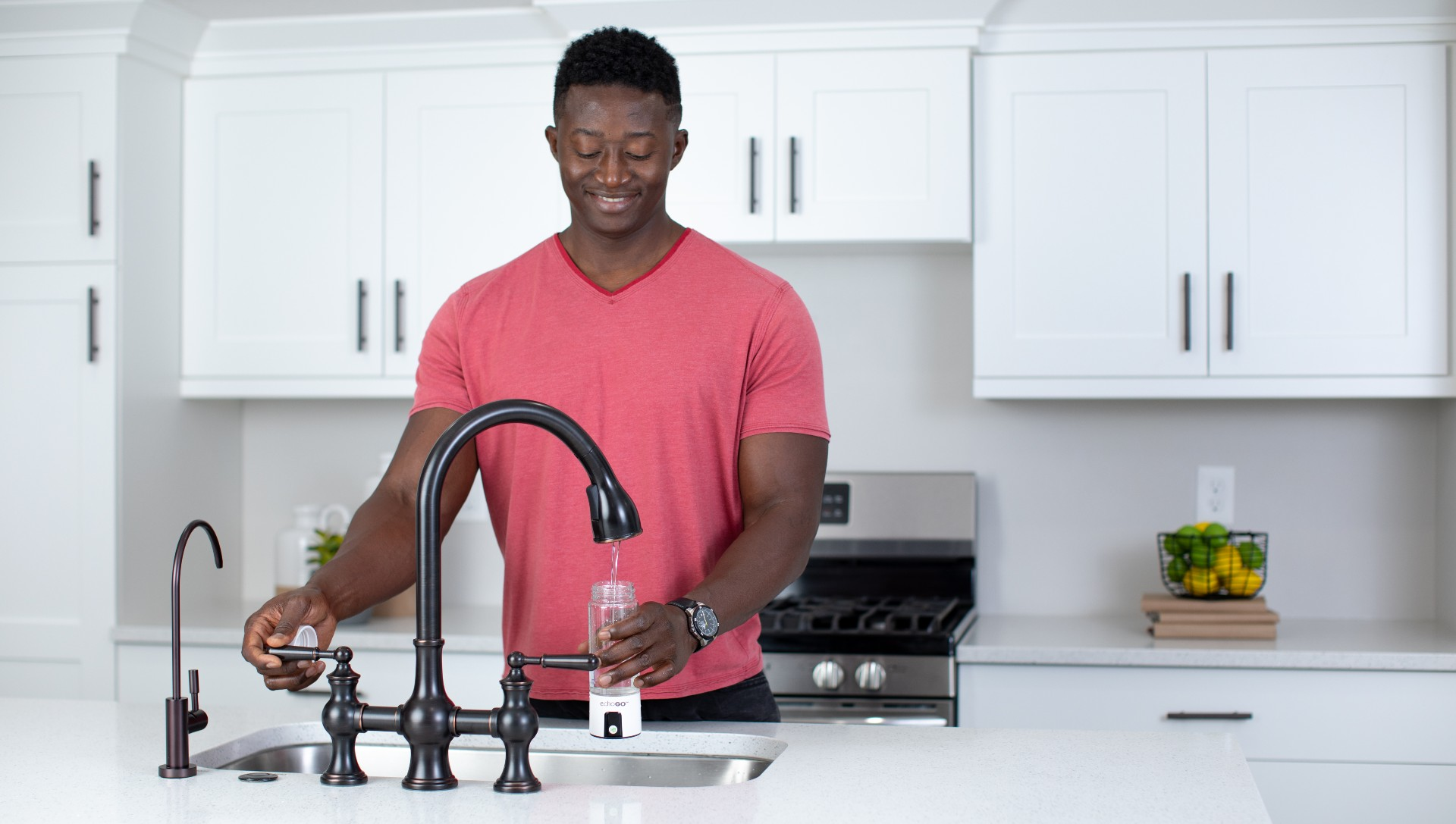 Man filling up his Echo Go hydrogen water bottle in his kitchen