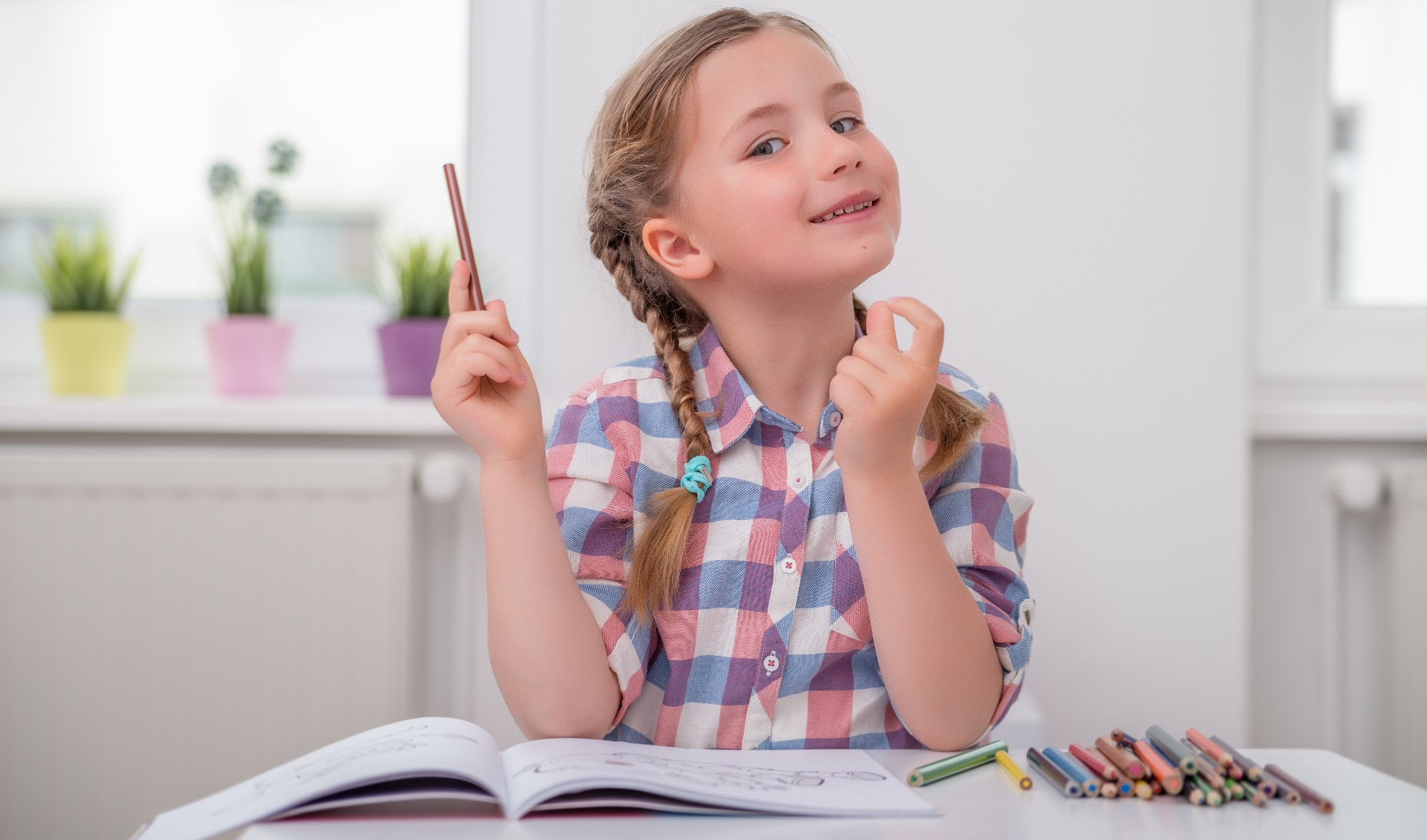 Small girl with a paper practicing problem solving
