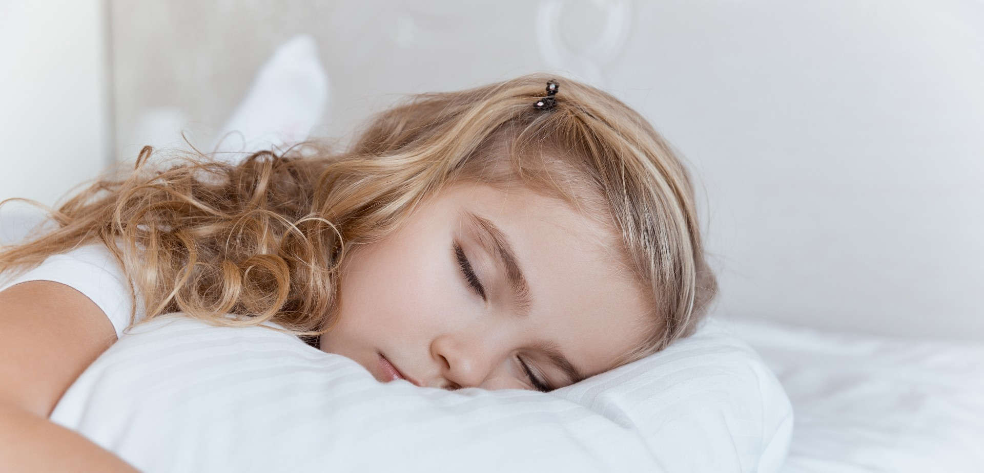 young girl sleeping on a pillow