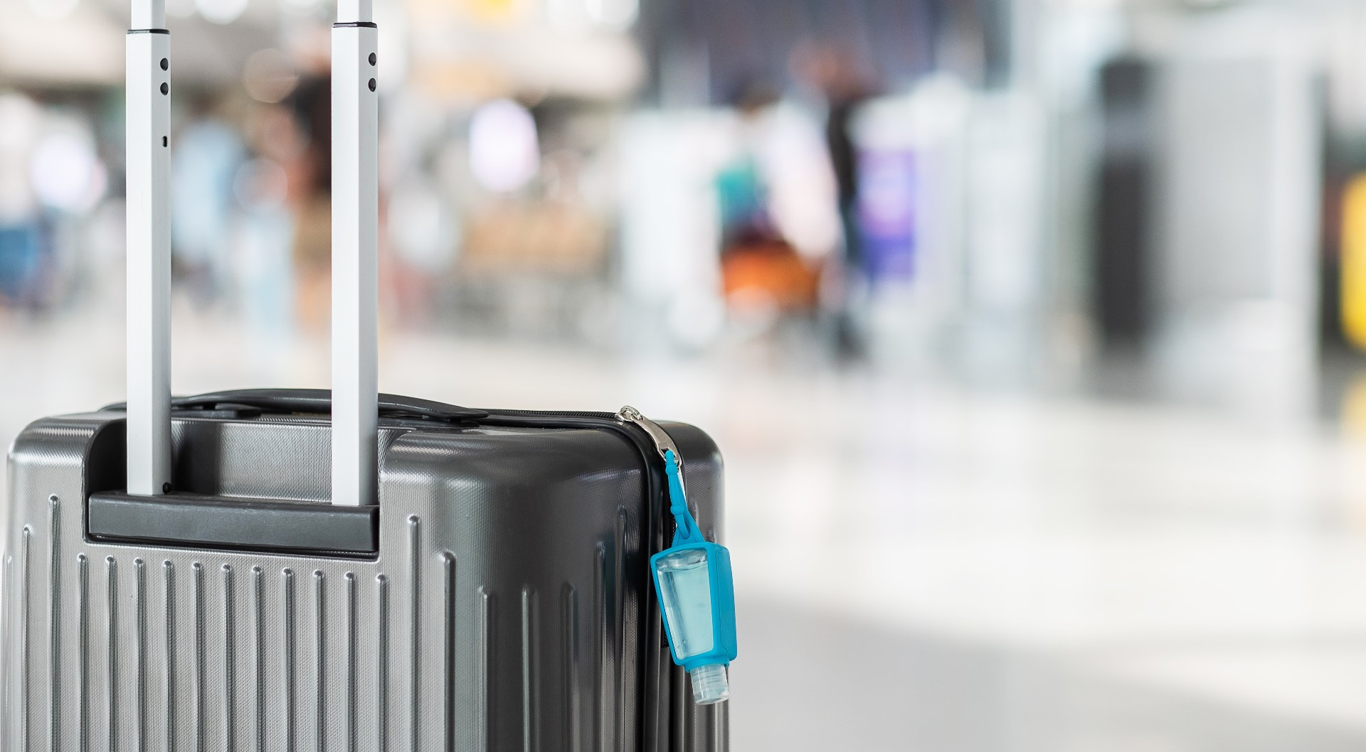 suitcase with hand sanitizer attached