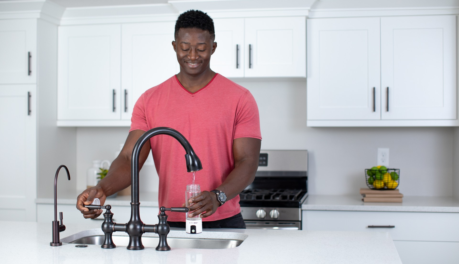 Man filling up Echo Go with tap water
